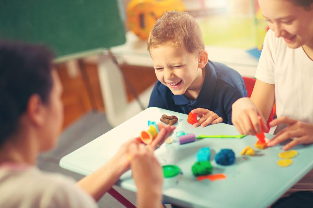 Kids Play Modeling Plasticine, Mother Helps Them