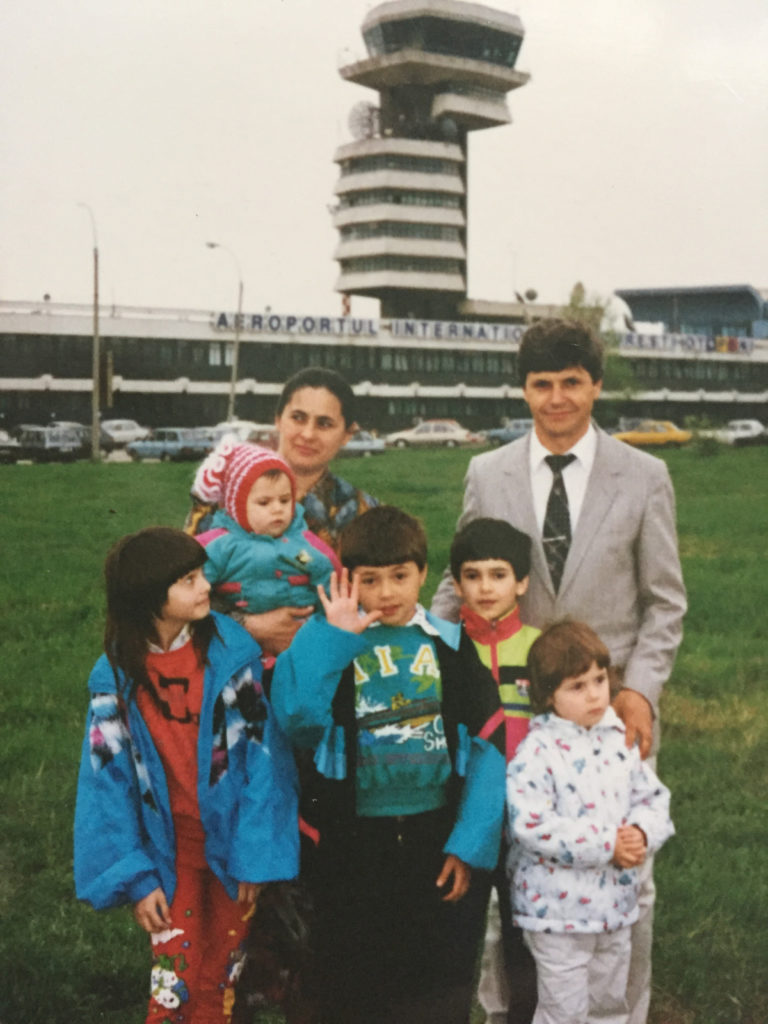 Family at an airport in Romania