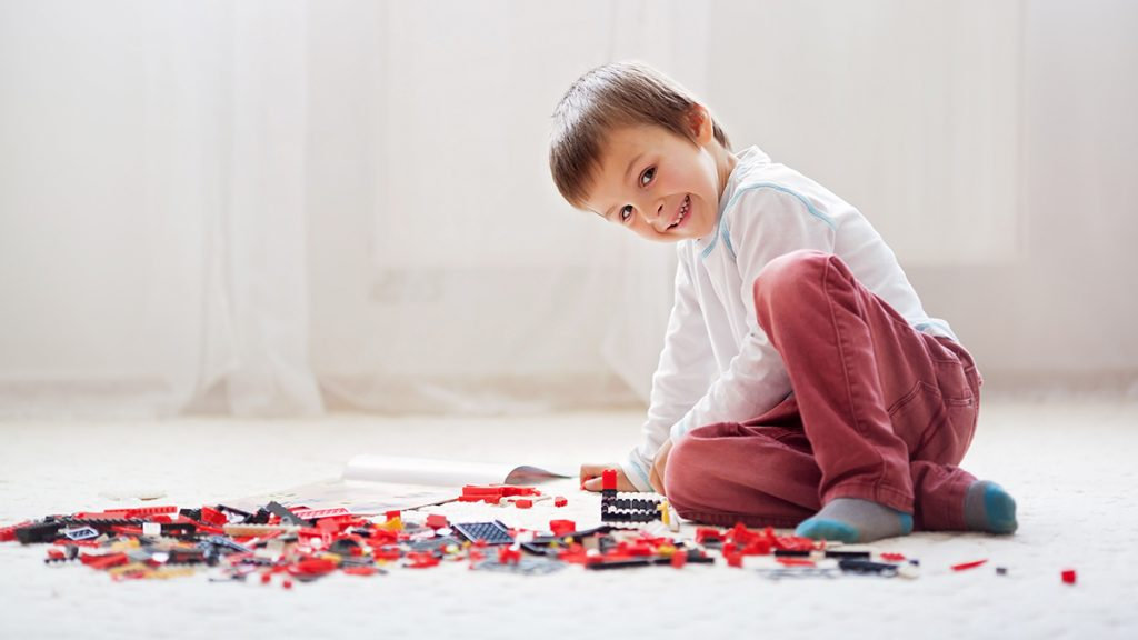 A boy playing with building blocks