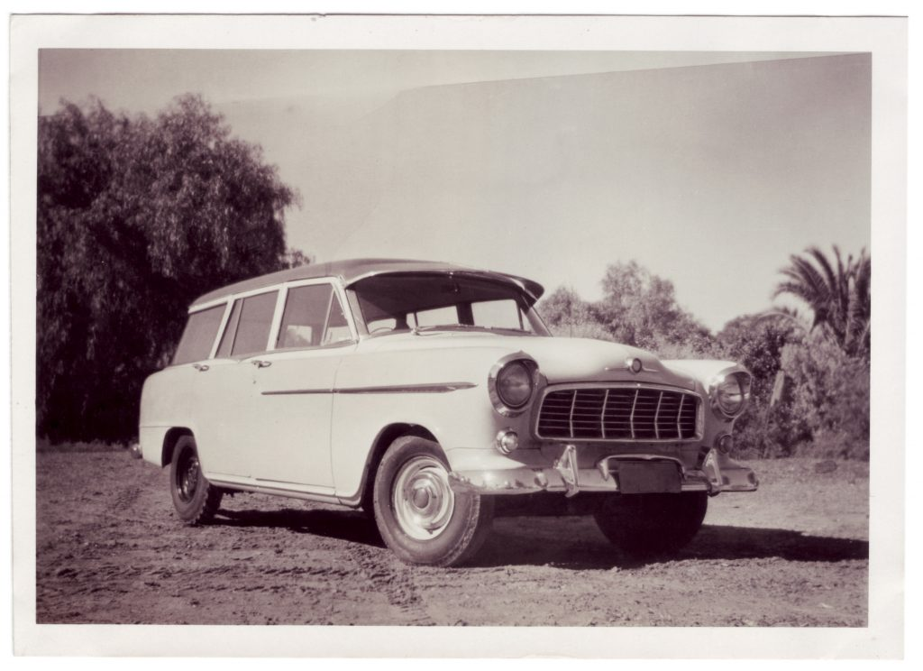 A black and white photograph of an old car
