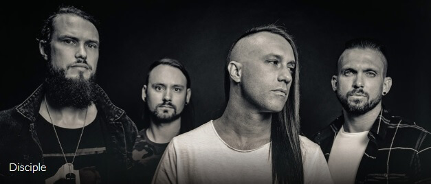 The four band members of Disciple in a black and white photo
